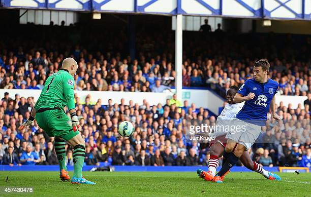 Seamus Coleman of Everton scores their third goal past Brad Guzan of Aston Villa during the Barclays Premier League match between Everton and Aston...