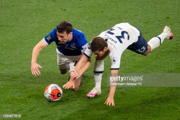 Seamus Coleman of Everton tackles Ben Davies of Tottenham Hotspur during the Premier League match between Tottenham Hotspur and Everton FC at...