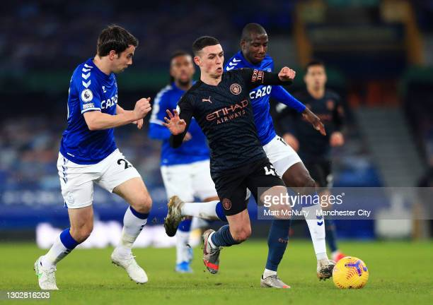 Seamus Coleman of Everton takes on Phil Foden of Manchester City during the Premier League match between Everton and Manchester City at Goodison Park...