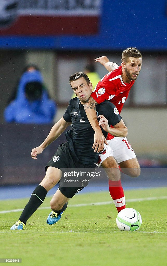 Seamus Coleman of Ireland (L) challenges Guido Burgstaller of Austria during the FIFA World Cup 2014 Group C qualification match between Austria and the Republic of Ireland at the Ernst Happel Stadium on September 10, 2013 in Vienna, Austria.