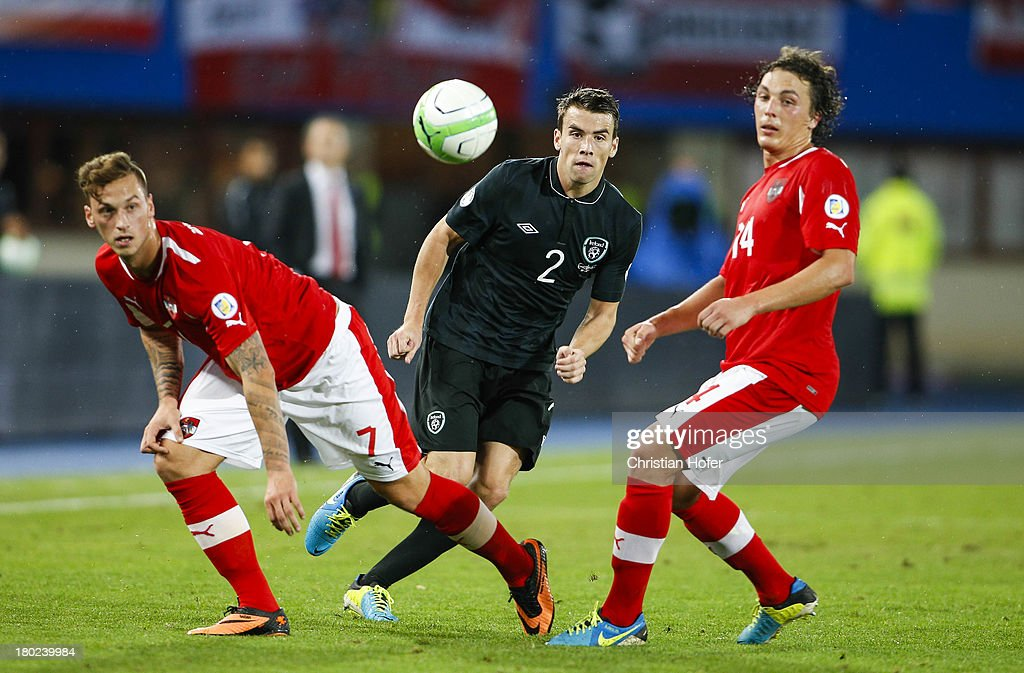 Seamus Coleman of Ireland (C) challenges Marko Arnautovic (L) and Julian Baumgartlinger of Austria during the FIFA World Cup 2014 Group C qualification match between Austria and the Republic of Ireland at the Ernst Happel Stadium on September 10, 2013 in Vienna, Austria.