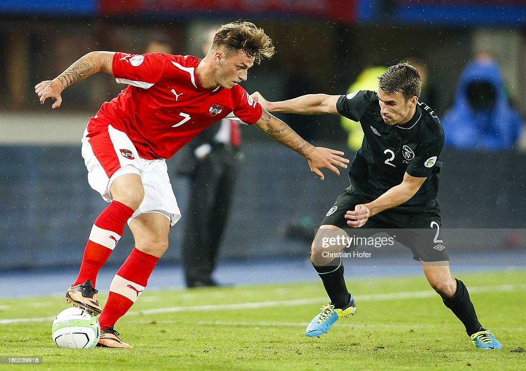 Seamus Coleman of Ireland (R) challenges Marko Arnautovic of Austria during the FIFA World Cup 2014 Group C qualification match between Austria and the Republic of Ireland at the Ernst Happel Stadium on September 10, 2013 in Vienna, Austria.