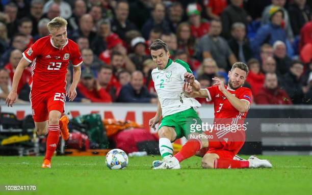 Seamus Coleman of Republic of Ireland and Paul Dummett of Wales challenge for the ball during UEFA Nations League between Wales and Republic Ireland...