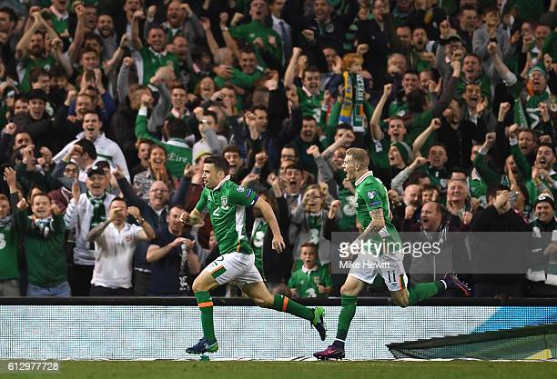 Seamus Coleman of Republic of Ireland celebrates scoring his sides first goal with team mate James McClean during the FIFA 2018 World Cup Group D...
