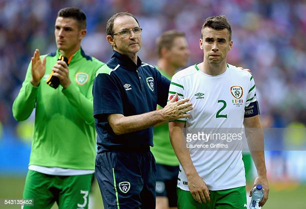 Seamus Coleman of Republic of Ireland is consoled by manager Martin O'Neill after their team's 12 defeat in the UEFA EURO 2016 round of 16 match...
