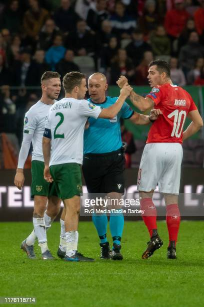Seamus Coleman of Republic of Ireland reacts with Granit Xhaka of Switzerland during the UEFA Euro 2020 qualifier between Switzerland and Republic of...