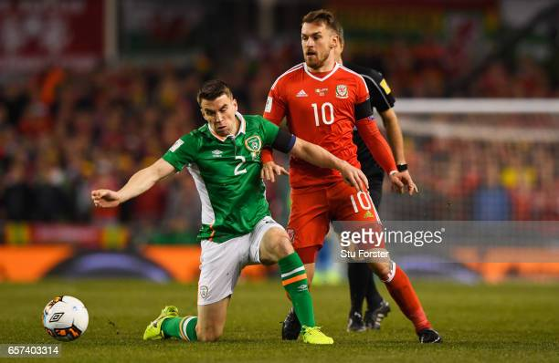 Seamus Coleman of the Republic of Ireland and Aaron Ramsey of Wales battle for the ball during the FIFA 2018 World Cup Qualifier between Republic of...