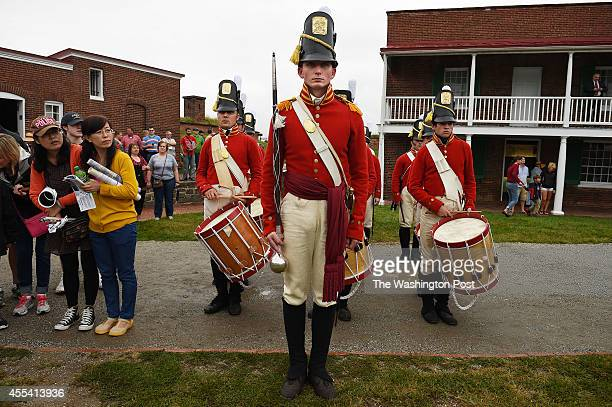 Seamus Ertel center of the Fort McHenry Guard Fife and Drum Corps stands with others during the StarSpangled Spectacular which celebrates the 200th...