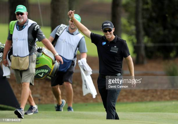 Seamus Power of Ireland acknowledges the crowds after he had holed in one on the par 3, third hole during the third round of the 2019 Players...