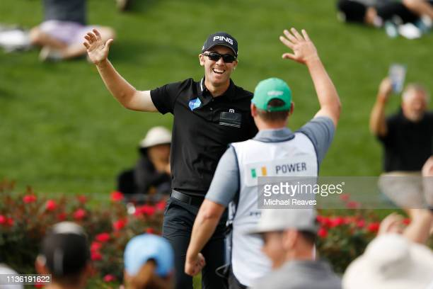Seamus Power of Ireland celebrates a hole in one on the third with caddy John Rathouz during the third round of The PLAYERS Championship on The...