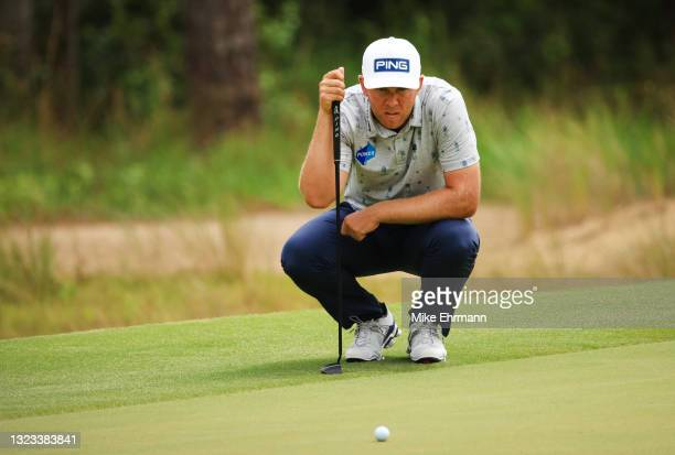 Seamus Power of Ireland lines up a putt on the 11th green during the final round of the Palmetto Championship at Congaree on June 13, 2021 in...
