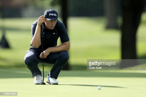 Seamus Power of Ireland lines up a putt on the fifth green during round one of the Rocket Mortgage Classic at the Detroit Country Club on June 27,...