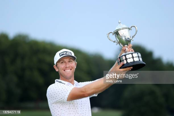 Seamus Power of Ireland poses with the trophy after putting in to win on the 18th hole during the sixth playoff hole during the final round of the...