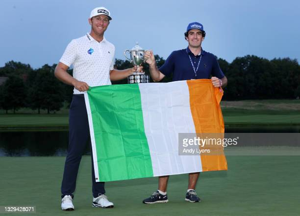 Seamus Power of Ireland poses with the trophy and his caddie Aaron Flener after putting in to win on the 18th hole during the sixth playoff hole...
