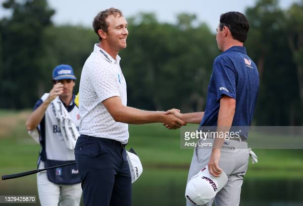 Seamus Power of Ireland reacts and shakes hands with J.T. Poston after putting in to win on the 18th hole during the sixth playoff hole during the...