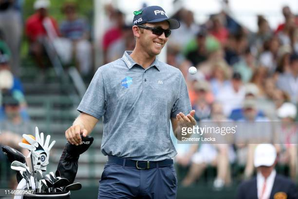 Seamus Power of Ireland tosses his golf ball on the first tee during the third round of the 2019 Wells Fargo Championship at Quail Hollow Club on May...