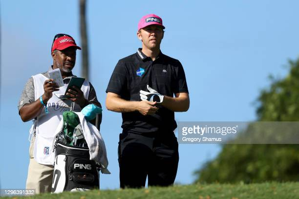 Seamus Power of Ireland waits with his caddie on the second tee during the first round of the Sony Open in Hawaii at the Waialae Country Club on...