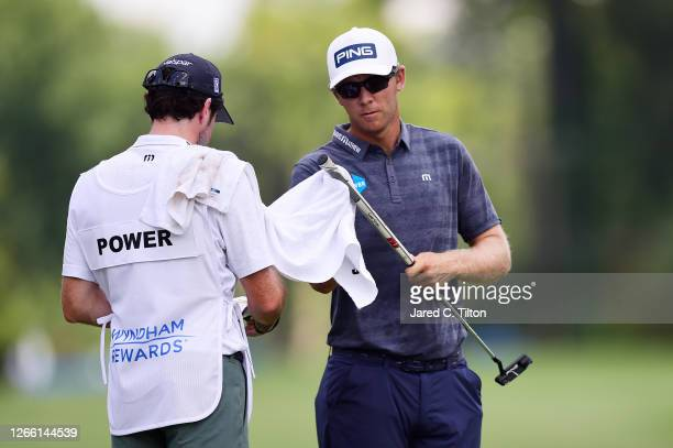 Seamus Power of Ireland wipes his putter grip during the first round of the Wyndham Championship at Sedgefield Country Club on August 13, 2020 in...