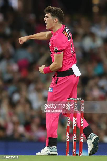 Sean Abbot of the Sixers celebrates taking the wicket of Dan Sams of the Thunder during the Big Bash League match between the Sydney Sixers and the...