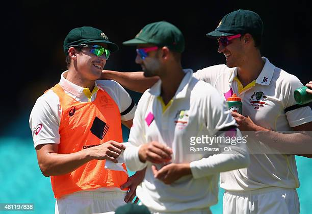 Sean Abbott and Mitchell Starc of Australia share a joke as Abbott runs drinks to his team mates during day four of the Fourth Test match between...