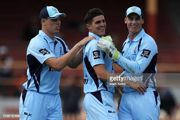 Sean Abbott of NSW Blues celebrates with his team mates Ben Dwarshuis and Jay Lenton of the NSW Blues after taking his fifth wicket dismissing Will...