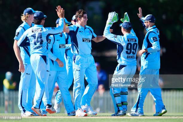 Sean Abbott of NSW celebrates with team mates after taking the wicket of Josh Phillippe of Western Australia during the 2021 Marsh One Day Cup Final...