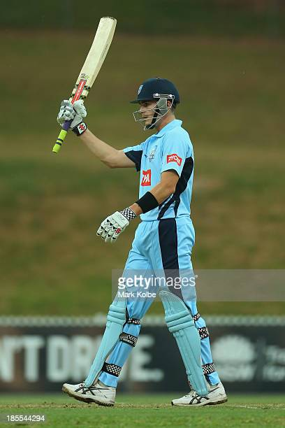 Sean Abbott of the Blues celebrates his half century during the Ryobi Cup one day match between the South Australia Redbacks and the New South Wales...