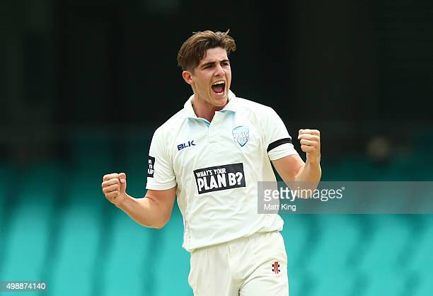 Sean Abbott of the Blues celebrates taking the wicket of Marnus Labuschagne of the Bulls during day one of the Sheffield Shield match between New...