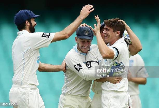 Sean Abbott of the Blues celebrates with team mates after taking the wicket of Nathan Reardon of the Bulls during day one of the Sheffield Shield...