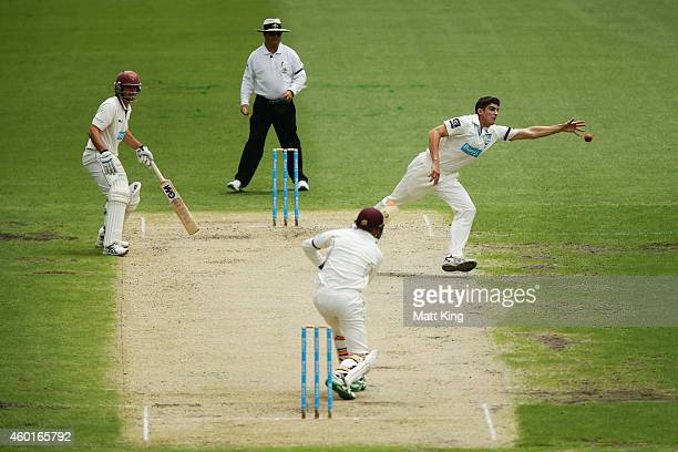 Sean Abbott of the Blues fields off his own bowling during day one of the Sheffield Shield match between New South Wales and Queensland at Sydney...