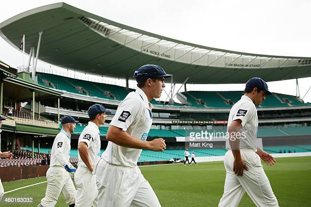 Sean Abbott of the Blues runs onto the field at the start of play during day one of the Sheffield Shield match between New South Wales and Queensland...