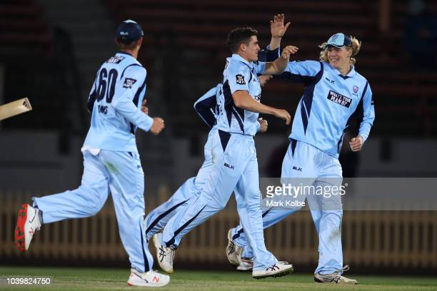 Sean Abbott of the NSW Blues celebrates with his team mates after taking the wicket of Ben McDermott of the Tigers during the JLT One Day Cup match...
