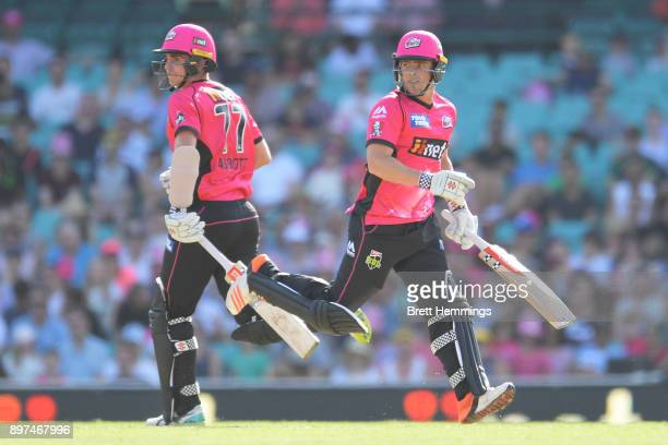 Sean Abbott of the Sixers and Stephen O'Keefe of the Sixers run between the wicket during the Big Bash League match between the Sydney Sixers and the...