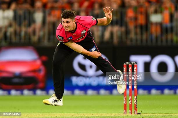 Sean Abbott of the Sixers bowls the ball during the Big Bash League match between the Perth Scorchers and the Sydney Sixers at Optus Stadium on...