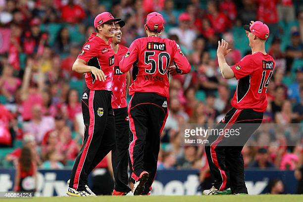 Sean Abbott of the Sixers celebrates a runout during the Big Bash League match between the Sydney Sixers and the Perth Scorchers at Sydney Cricket...