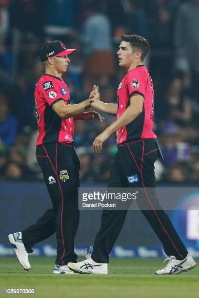 Sean Abbott of the Sixers celebrates after dismissing Alex Doolan of the Hurricanes during the Big Bash League match between the Hobart Hurricanes...