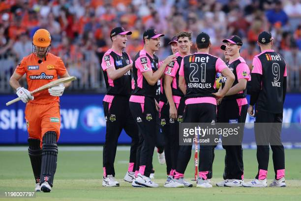 Sean Abbott of the Sixers celebrates after taking the wicket of Mitch Marsh of the Scorchers during the Big Bash League match between the Perth...