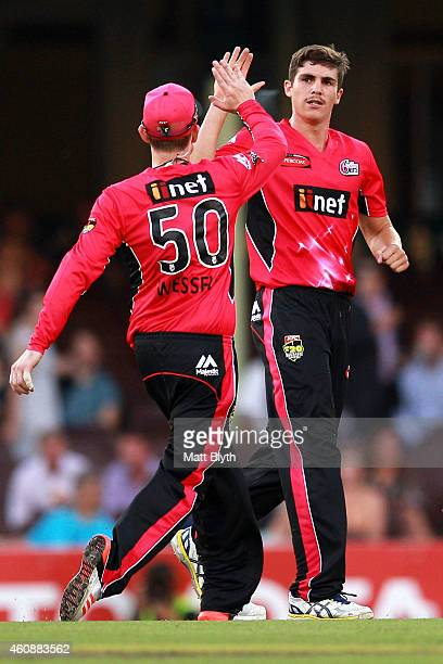 Sean Abbott of the Sixers celebrates after taking the wicket of Michael Klinger of the Scorchers during the Big Bash League match between the Sydney...