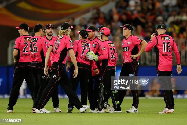 Sean Abbott of the Sixers celebrates after taking the wicket of Sam Whiteman of the Scorchers during the Big Bash League match between the Perth...