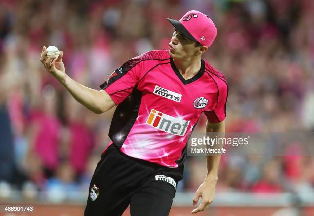 Sean Abbott of the Sixers celebrates taking a catch to dismiss Sam Whiteman of the Scorchers off the bowling of Brett Lee during the Big Bash League...