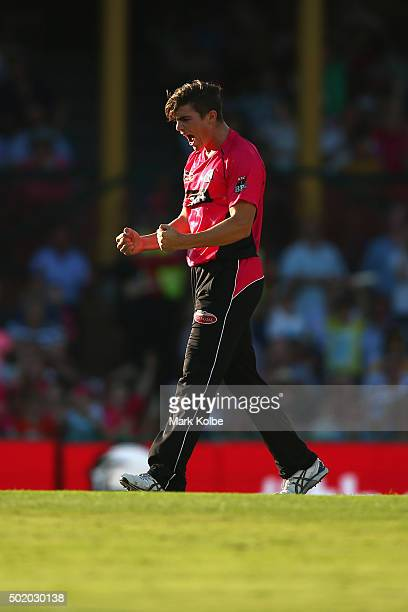 Sean Abbott of the Sixers celebrates taking the wicket of Darren Sammy of the Hurricanes during the Big Bash League match between the Sydney Sixers...