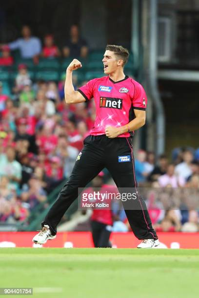 Sean Abbott of the Sixers celebrates taking the wicket of Shane Watson of the Thunder during the Big Bash League match between the Sydney Sixers and...