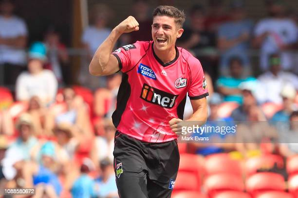 Sean Abbott of the Sixers celebrates the wicket of Brendon McCullum of the Heat during the Big Bash League match between the Brisbane Heat and the...