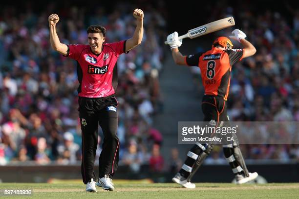 Sean Abbott of the Sixers celebrates the wicket of David Willey of the Scorchers during the Big Bash League match between the Sydney Sixers and the...