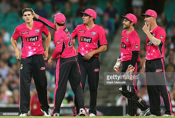 Sean Abbott of the Sixers celebrates with team mates after taking the wicket of Dwayne Bravo of the Renegades during the Big Bash League match...