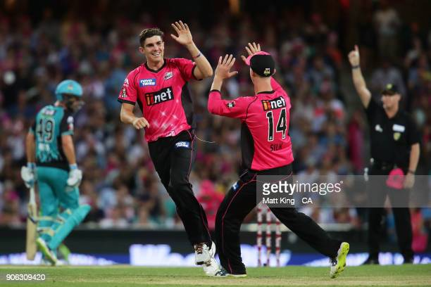 Sean Abbott of the Sixers celebrates with team mates after taking the wicket of Jimmy Pierson of the Heat during the Big Bash League match between...