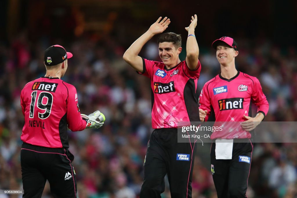 Sean Abbott of the Sixers celebrates with team mates after taking the wicket of Jimmy Pierson of the Heat during the Big Bash League match between the Sydney Sixers and the Brisbane Heat at Sydney Cricket Ground on January 18, 2018 in Sydney, Australia.
