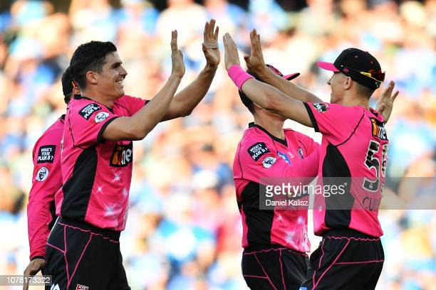 Sean Abbott of the Sixers celebrates with Tom Curran of the Sixers during the Big Bash League match between the Adelaide Strikers and the Sydney...
