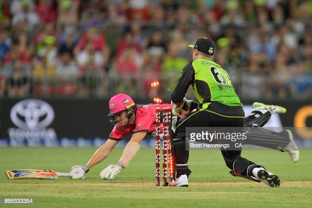 Sean Abbott of the Sixers is run out by Jos Buttler of the Thunder during the Big Bash League match between the Sydney Thunder and the Sydney Sixers...