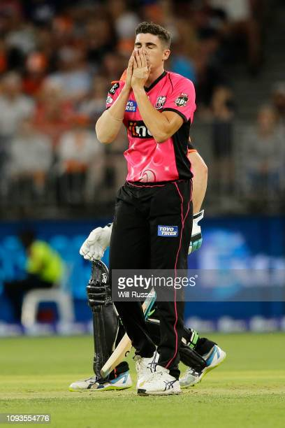 Sean Abbott of the Sixers reacts after just missing the wicket during the Big Bash League match between the Perth Scorchers and the Sydney Sixers at...